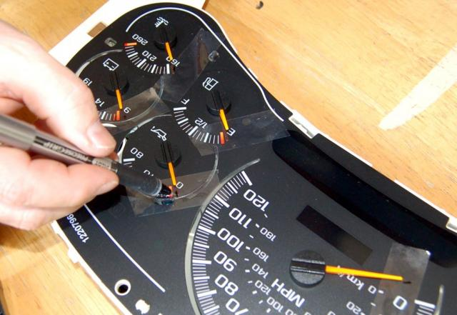 Make dials with tape.