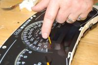 Realign dials: Realign.  the dials with the marks you made earlier.