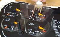 Remove dial pointers: Use a fork to pry off the dials after they have been marked.